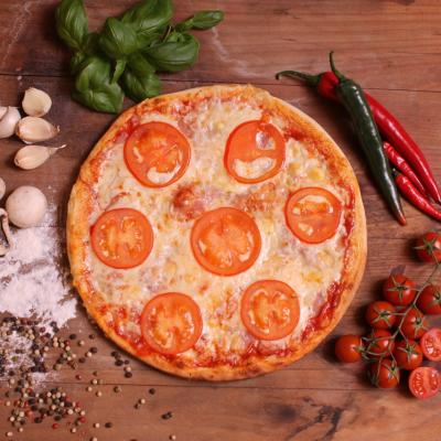 Pizza with sliced tomato